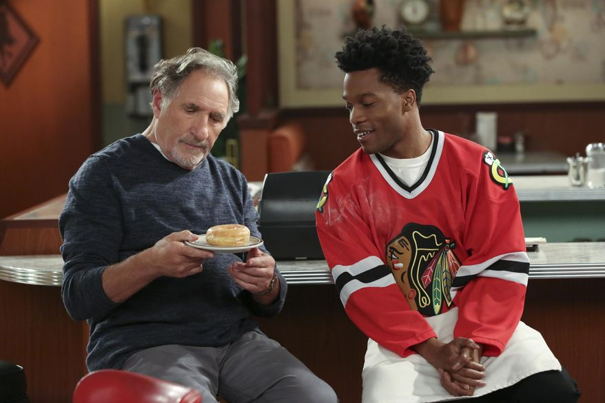 "This image released by CBS shows Judd Hirsch, left, and Jermaine Fowler in a scene from the new comedy series, ""Superior Donuts,"" premiering  Thursday, Feb. 2, on CBS. (Michael Yarish/CBS via AP)"