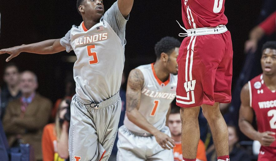 Wisconsin forward Aaron Moesch (5) shoots over Illinois guard Jalen Coleman-Lands (5) during the first half of an NCAA college basketball game in Champaign, Ill., Tuesday, Jan. 31, 2017. (AP Photo/Rick Danzl)