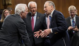 From left: Republican Sens. John Cornyn of Texas, Orrin G. Hatch of Utah and Chuck Grassley of Iowa confer on Wednesday after the Judiciary Committee, after angry partisan exchanges, voted to approve the nomination of Jeff Sessions as attorney general. (Associated Press)