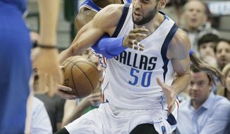 Dallas Mavericks center Salah Mejri (50) and Philadelphia 76ers forward Nerlens Noel (4) vie for control of the ball during the first half of an NBA basketball game in Dallas, Wednesday, Feb. 1, 2017. (AP Photo/LM Otero)
