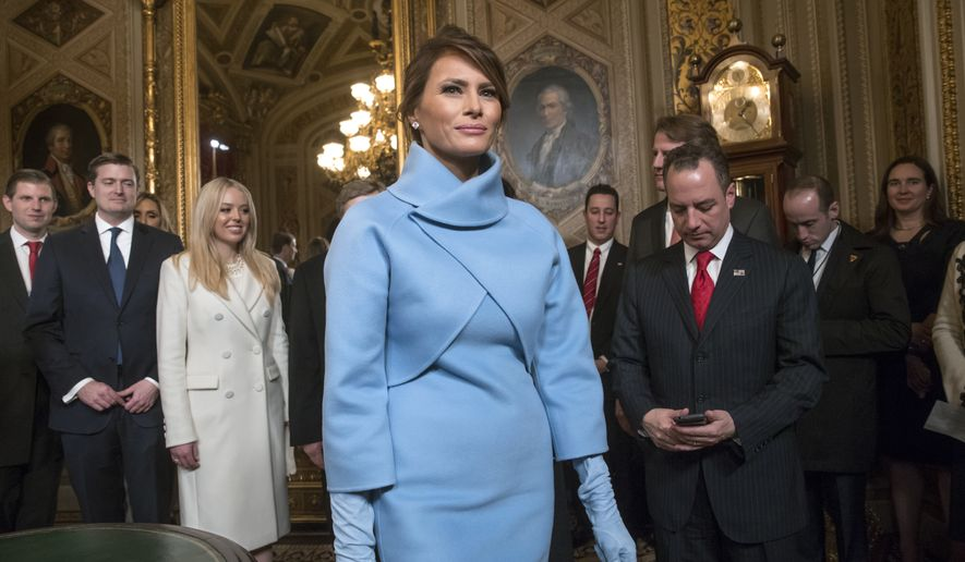 Melania Trump, the wife of President Donald Trump, leaves the President's Room of the Senate, at the Capitol in Washington, Friday, Jan. 20, 2017, after President Trump signed his first legislation. (AP Photo/J. Scott Applewhite, Pool)