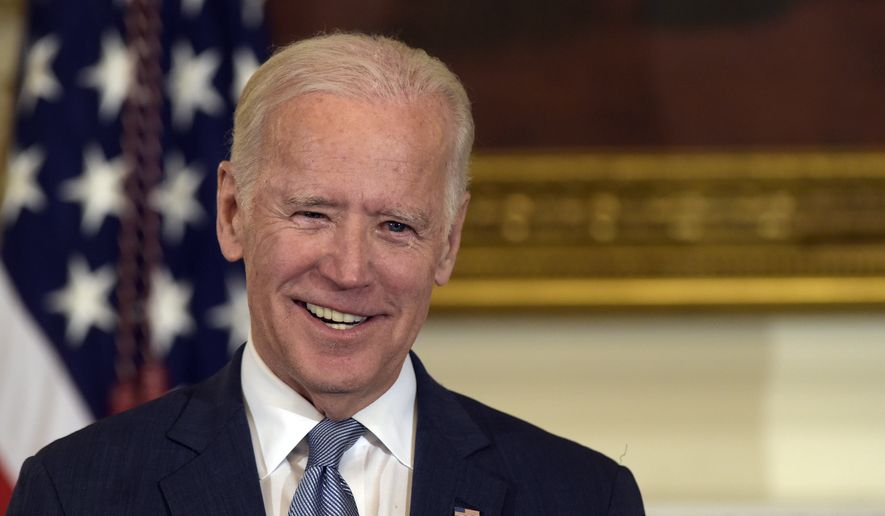 Vice President Joe Biden smiles in the State Dining Room of the White House in Washington, in this Jan. 12, 2017, file photo. (AP Photo/Susan Walsh, File)