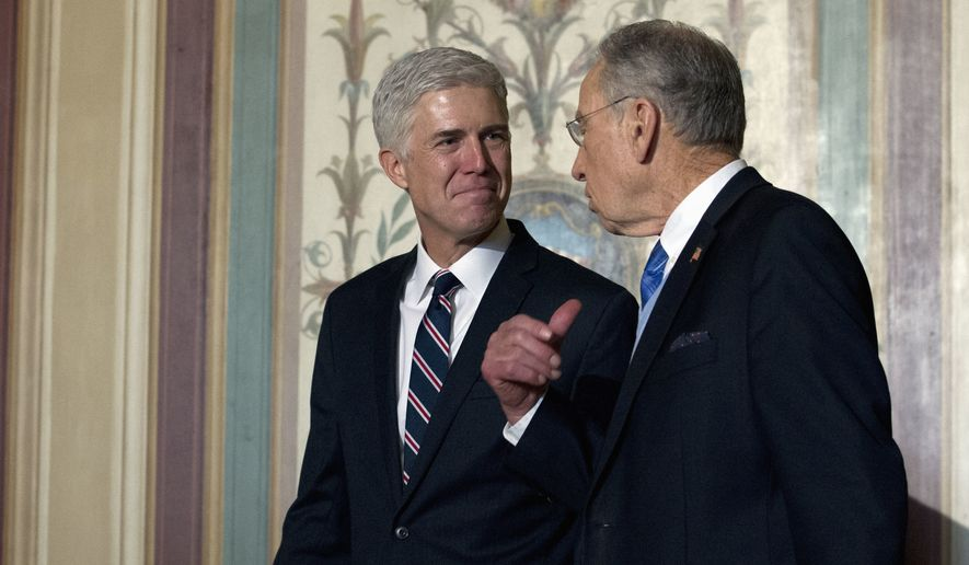 Supreme Court Justice nominee Neil Gorsuch (left) met Wednesday with Senate Judiciary Committee Sen. Chuck Grassley, Iowa Republican, and other senators on Capitol Hill. (Associated Press)