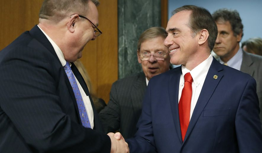 The Senate Veterans' Affairs Committee Ranking member Jon Tester, D-Mont., left, with committee chairman Sen. Johnny Isakson, R-Ga., center, shakes hands with Veterans Affairs Secretary-designate Dr. David Shulkin on Capitol Hill in Washington, Wednesday, Feb. 1, 2017, prior to the start of Shulkin's confirmation hearing before the committee.  (AP Photo/Alex Brandon)