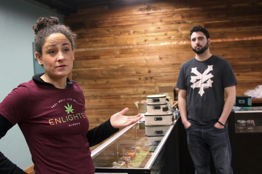 "This Jan. 23, 2017 photo shows the Leah Levinton, left, and her brother Evan Levinton, co-owners of Enlighten Alaska, a marijuana retail store in Anchorage, Alaska, planning for the store's opening. Leah Levinton envisions an Anchorage ""green light district,"" where scores of tourists come on buses to try the offerings at four retail stores in the city's Spenard neighborhood. (AP Photo/Mark Thiessen)"