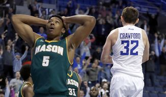 George Mason's Jaire Grayer (5) reacts after Saint Louis' Mike Crawford (32) hit the game-winning shot at the buzzer during the second overtime of an NCAA college basketball game Wednesday, Feb. 1, 2017, in St. Louis. Saint Louis won 76-74. (AP Photo/Jeff Roberson) **FILE**