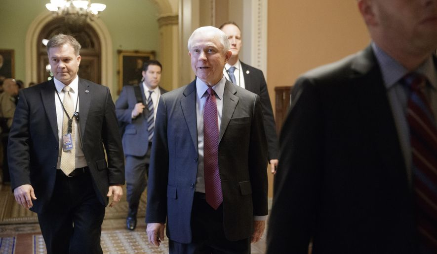 Attorney General-designate Sen. Jeff Sessions, R-Ala. is surrounded by security as he walks on Capitol Hill in Washington, Wednesday, Feb. 1, 2017,  as the Senate Judiciary Committee prepares to advance his nomination. (AP Photo/J. Scott Applewhite)