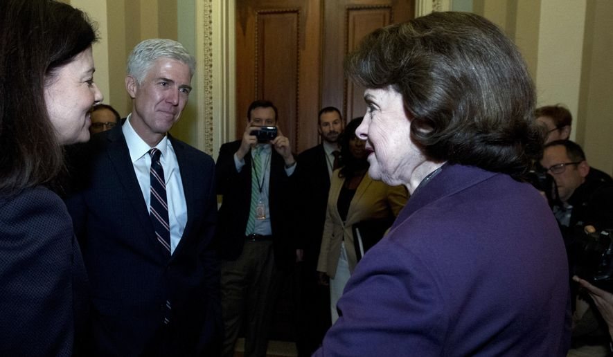 Supreme Court Justice nominee Neil Gorsuch, accompanied by former New Hampshire Sen. Kelly Ayotte, left, meets with Sen. Dianne Feinstein D-Calif., ranking member of the Senate Judiciary Committee, on Capitol Hill in Washington, Wednesday, Feb. 1, 2017.  (AP Photo/Jose Luis Magana)
