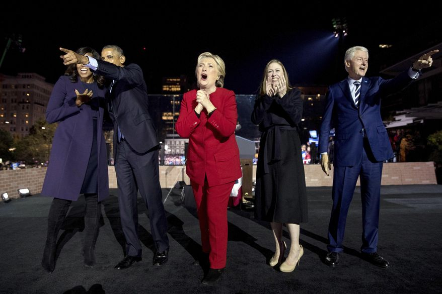 In this Monday, Nov. 7, 2016, file photo, Democratic presidential candidate Hillary Clinton, center, is joined onstage by first lady Michelle Obama, left, President Barack Obama, second from left, Chelsea Clinton, second from right, and former President Bill Clinton, right, after speaking at a rally at Independence Mall in Philadelphia. (AP Photo/Andrew Harnik, File)