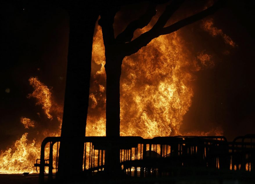 A fire set by demonstrators protesting a scheduled speaking appearance by Breitbart News editor Milo Yiannopoulos burns on Sproul Plaza on the University of California at Berkeley campus on Wednesday, Feb. 1, 2017, in Berkeley, Calif. The event was cancelled due to size of the crowd and several fires being set. (AP Photo/Ben Margot)