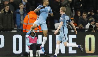 Manchester City's Gabriel Jesus, left, celebrates with Manchester City's Kevin De Bruyne after he scores a goal during the English Premier League soccer match between West Ham and Manchester City at the London stadium, Wednesday, Feb. 1, 2017. (AP Photo/Frank Augstein)