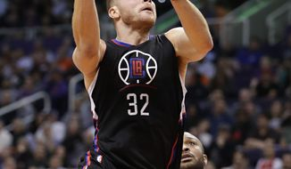 Los Angeles Clippers forward Blake Griffin (32) drives past Phoenix Suns forward P.J. Tucker (17) during the first half of an NBA basketball game, Wednesday, Feb. 1, 2017, in Phoenix. (AP Photo/Matt York)