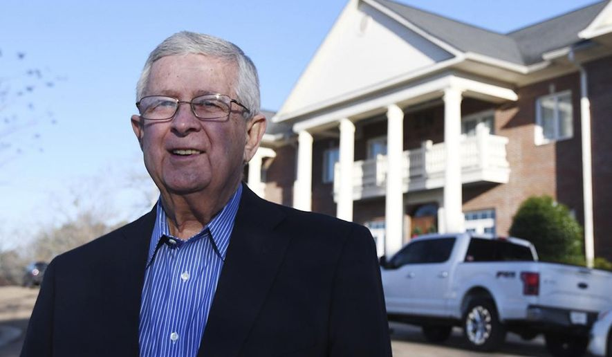 In this January 2017 photo, Ed Meek poses for a photo in Oxford, Miss. Meek was inducted Sunday, Jan. 29, 2017, into the Sigma Nu fraternity at the University of Mississippi. Meek had to drop out of the chapter weeks after he pledged nearly six decades ago, but remained friends with members. (Bruce Newman/The Oxford Eagle via AP)
