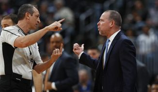 Denver Nuggets coach Michael Malone, right, argues with referee J.T. Orr after Orr ejected guard Jameer Nelson during the first half of the team's NBA basketball game against the Memphis Grizzlies on Wednesday, Feb. 1, 2017, in Denver. (AP Photo/David Zalubowski) **FILE**