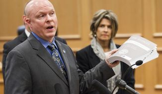 Republican Rep. David Hawk of Greeneville presents his proposal to boost transportation without a gas tax during a press conference at the legislative office complex in Nashville, Tenn., on Wednesday, Feb. 1, 2017. Rep. Terri Lynn Weaver, R-Lancaster, looks on at right. (AP Photo/Erik Schelzig)