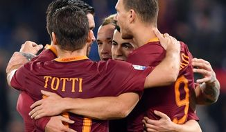 Roma's Edin Dzeko, right, celebrates with his teammates after scoring a goal during the Italians Cup quarterfinal soccer match between Roma and Cesena at the Olympic stadium in Rome, Wednesday, Feb. 1, 2017. (Ettore Ferrari/ANSA via AP)
