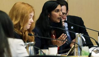 City Council member Kshama Sawant, center, speaks during a meeting of the City of Seattle's Finance Committee, as she advocates that the city divest from using Wells Fargo Bank, Wednesday, Feb. 1, 2017, at City Hall in Seattle. The committee was discussing whether Seattle should stop using the bank, due in part to Wells Fargo's role as a lender to the builders of the Dakota Access Pipeline. (AP Photo/Ted S. Warren)