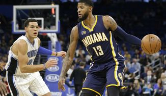 Indiana Pacers' Paul George (13) makes a move to get around Orlando Magic's Aaron Gordon, left, during the first half of an NBA basketball game, Wednesday, Feb. 1, 2017, in Orlando, Fla. (AP Photo/John Raoux)