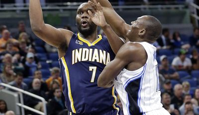 Indiana Pacers' Al Jefferson (7) shoots next Orlando Magic's Bismack Biyombo during the first half of an NBA basketball game, Wednesday, Feb. 1, 2017, in Orlando, Fla. (AP Photo/John Raoux)