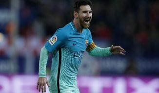 Barcelona's Lionel Messi celebrates after scoring his side's second goal against Atletico Madrid during a Spanish Copa del Rey semifinal first leg soccer match between Atletico Madrid and Barcelona at the Vicente Calderon stadium in Madrid, Wednesday, Feb. 1, 2017. (AP Photo/Francisco Seco)