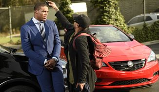 This Jan. 13, 2017 photo shows NFL player Cam Newton getting primped during the filming of a Buick commercial for this year's Super Bowl telecast  in Los Angeles. The commercial is set to air during the first quarter. (Photo by Chris Pizzello/Invision/AP)