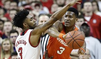 Syracuse's Andrew White III (3) passes while North Carolina State's Terry Henderson (3) defends during the first half of an NCAA college basketball game in Raleigh, N.C., Wednesday, Feb. 1, 2017. (AP Photo/Gerry Broome)