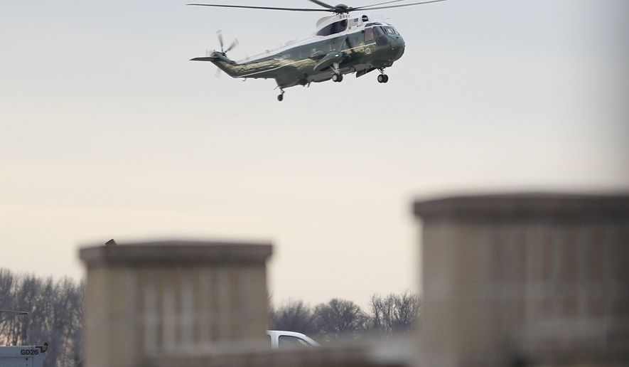 """Marine One, with President Donald Trump aboard, lands at Dover Air Force Base, Del. Wednesday, Feb. 1, 2017. Trump traveled to Dover AFB to meet with family members Chief of Special Warfare Operator William """"Ryan"""" Owens, 36, of Peoria, Ill, the U.S. service member who was killed in a raid in Yemen, and who's remains where returned today. Owens is the first-know combat death of a member of the U.S. military under Trump's administration. (AP Photo/Pablo Martinez Monsivais)"""