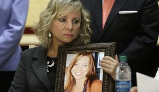 FILE - In this Aug. 18, 2015 file photo, Debbie Ziegler holds a photo of her daughter, Brittany Maynard, who moved from California to Oregon to end her life, during a news conference to announce the reintroduction of right to die legislation, in Sacramento, Calif. Supporters of a terminally ill person's right to take his or her own life are alarmed by President Donald Trump's nominee for the vacant U.S. Supreme Court seat. They fear Neil Gorsuch could quash a growing right-to-die movement that has made gains in recent years.  (AP Photo/Rich Pedroncelli, File)