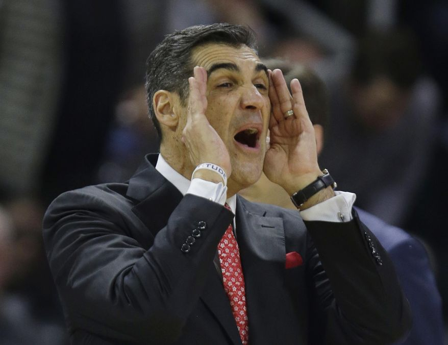 Villanova head coach Jay Wright expresses his displeasure at his team's performance against Providence during the first half of their NCAA college basketball game, Wednesday, Feb. 1, 2017, in Providence, R.I. (AP Photo/Stephan Savoia)