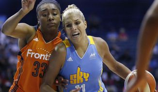FILE - In this July 22, 2016, file photo, Chicago Sky forward Elena Delle Donne, right, drives as Connecticut Sun forward Morgan Tuck defends during a WNBA basketball game in Rosemont, Ill. There have been three trades in the last five days and at least one more is set to be done soon with Delle Donne heading to Washington according to two people familiar with the situation. The people spoke on condition of anonymity because the deal hasn't been finalized yet. (AP Photo/Nam Y. Huh, File)