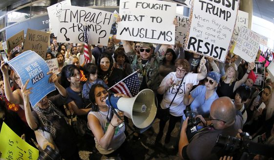 """When President Trump arrives in Florida for the weekend, protesters have planned a """"March to Mar-a-Lago for Humanity"""" to greet him. (Associated Press)"""