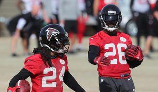 Atlanta Falcons running backs Devonta Freeman (left) and Tevin Coleman feel like brothers. They're going to enjoy it while they can, because this is not likely to be a long-term partnership with Freeman seeking a new contract in the offseason. (Associated Press)