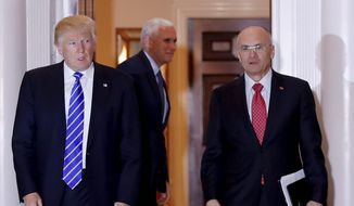 Employees praise Labor Secretary-designate Andy Puzder (right) despite his minimum wage stances. (Associated Press)