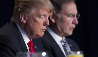President Donald Trump and Sen. John Boozman, R-Ark., pause during the National Prayer Breakfast, Thursday, Feb. 2, 2017, in Washington. (AP Photo/Evan Vucci)