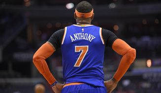 New York Knicks forward Carmelo Anthony looks on during the first half of an NBA basketball game against the Washington Wizards, Tuesday, Jan. 31, 2017, in Washington. (AP Photo/Nick Wass)