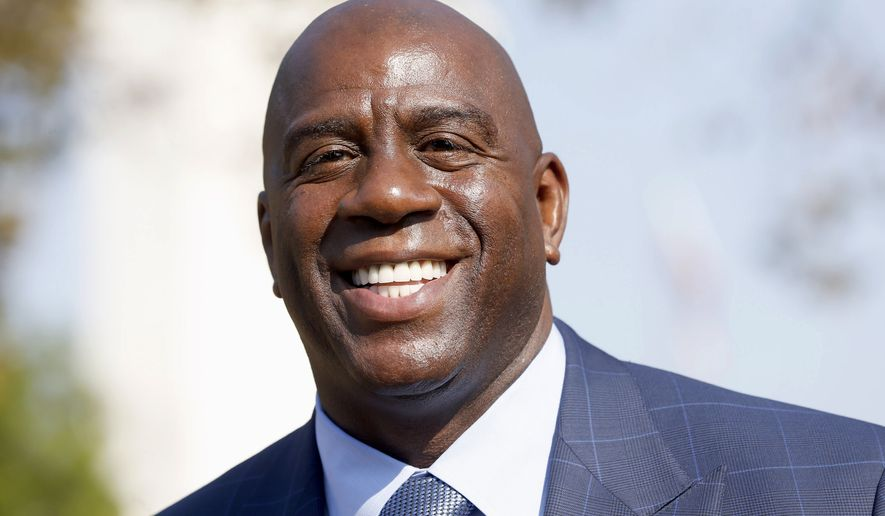 In this Aug. 23, 2016, file photo, former Los Angeles Lakers star Magic Johnson speaks at a groundbreaking ceremony for a stadium which will be home to the Los Angeles Football Club in Los Angeles. Johnson is returning to the Los Angeles Lakers organization as an adviser to owner Jeanie Buss. The Lakers announced the reunion Thursday, Feb. 2, 2017, with Johnson, one of the most beloved players in franchise history. (AP Photo/Nick Ut, File)