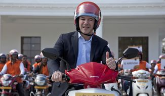 Uber CEO Travis Kalanick, poses during the launch of its bike-sharing product, uberMOTO, in Hyderabad, India, in this Dec. 13, 2016, file photo. Kalanick has quit President Donald Trump's council of business leaders, according to an internal memo obtained by The Associated Press. (AP Photo/Mahesh Kumar A., File)
