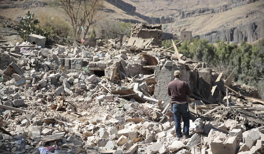 A man walks amid the rubble of a house destroyed by a Saudi-led airstrike on the outskirts of Sanaa, Yemen, Thursday, Feb. 2, 2017. (AP Photo/Hani Mohammed) ** FILE **