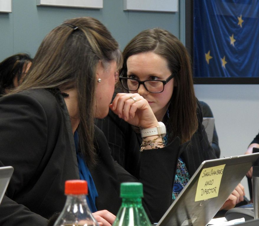 Sara Chambers, left, acting director of Alaska's Alcohol and Marijuana Control Office confers with the office's program coordinator, Sarah Oates, on Thursday, Feb. 2, 2017, in Juneau, Alaska. The board is expected to consider rules for allowing authorized retail pot shops to have areas where customers can consume marijuana products. (AP Photo/Becky Bohrer)