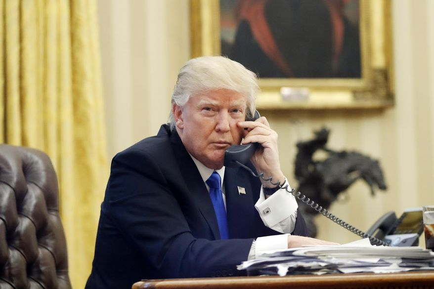In this Jan. 28, 2017, file photo, U.S. President Donald Trump speaks on the phone with Prime Minister of Australia Malcolm Turnbull in the Oval Office of the White House in Washington. (AP Photo/Alex Brandon, File)