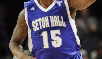 FILE - In this March 7, 2012, file photo, Seton Hall's Herb Pope (15) reacts after making a 3-pointer in the first half during a second-round NCAA college basketball game against Louisville at the Big East tournament in New York. Pope, a western Pennsylvania high school basketball prospect who later starred at Seton Hall, pleaded guilty Thursday, Feb. 2, 2017, to robbing a bank last February. Because he pleaded guilty to brandishing a gun during the heist, Pope's attorney says he'll likely face more than nine years in federal prison. (AP Photo/Frank Franklin II, File)