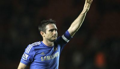 "FILE - Saturday, Jan. 5, 2013, file photo shows Frank Lampard waving to the supporters at the end of their English FA Cup third round soccer match against Southampton. Former Chelsea midfielder Frank Lampard says he is retiring from soccer and will study to become a coach. Lampard made the announcement on Facebook on Thursday Feb. 2, 2017, saying he turned down ""a number of exciting offers to continue playing at home and abroad ... to begin the next chapter in my life."" (AP Photo/Sang Tan, File)"
