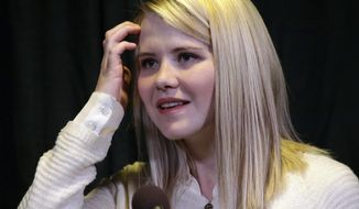 FILE - In this April 24, 2015, file photo, kidnapping survivor Elizabeth Smart looks on during a news conference in Sandy, Utah. Authorities arrested Claude Hudson, of Terre Haute, Ind., who they say punched a police officer who stopped him from approaching Smart with a knife while she was signing books at an event Monday, Jan. 31, 2017, at Indiana State University. Hudson pleaded not guilty to battery Wednesday, Feb. 1. (AP Photo/Rick Bowmer, File)