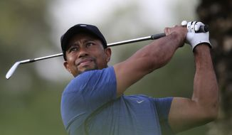 Tiger Woods tees off on the 11th hole during the first round of the Dubai Desert Classic golf tournament in Dubai, United Arab Emirates, Thursday, Feb. 2, 2017. (AP Photo/Kamran Jebreili)