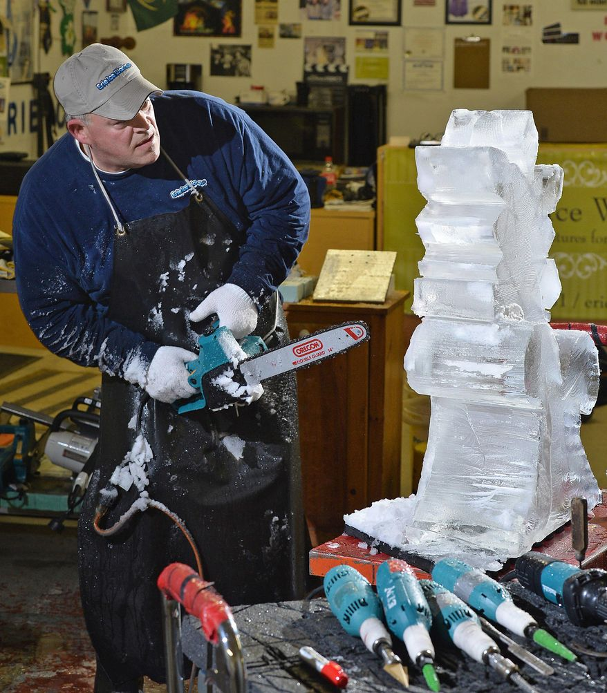 FOR RELEASE SATURDAY, FEBRUARY 4, 2017, AT 3:01 A.M. EST.- This photo taken Jan. 25, 2017, shows Bill Sandusky using custom-made electric hand tools to create ice carvings at Erie Ice Works, in Erie, Pa. Sandusky has been carving ice for more than 25 years, at one point he was competing throughout the United States and Europe. These days, he's content appearing at winter festivals and running his business, which he opened in 2013 after returning to Erie in 2012 following a 12-year stay in Colorado. (Christopher Millette/Erie Times-News via AP)