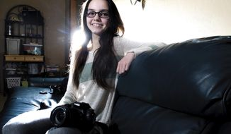 ADVANCE FOR USE SATURDAY, FEB. 4, 2017 AND THEREAFTER - In this Jan. 15,  2017 photo, budding photographer Rock Falls High School freshman Morgan Lewis is seen with her camera, in Rock Falls, Ill. Morgan already knows she wants to be a photographer when she grows up, and her grandparents, Doreen and Ron Bontz, spurred her with an upgrade with her camera equipment. (Alex T. Paschal/Sauk Valley Media via AP)