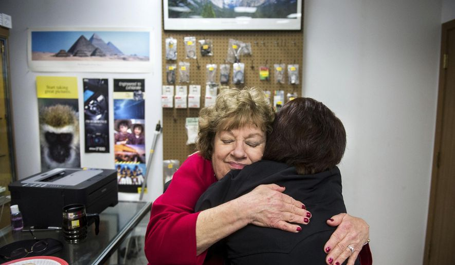 ADVANCE FOR USE SATURDAY, FEB. 4, 2017 AND THEREAFTER - In this Jan. 17,  2017 photo, Linda Potter, left, gets a goodbye hug from photographer and long-time customer Nancy Davis as Rex Camera Shop prepares to close after 106 years in business, in Peoria, Ill. Linda and her husband, Allen, plan to call it quits as the camera retail business has changed greatly over the years. (Fred Zwicky/Journal Star via AP)