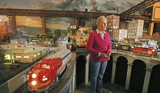 ADVANCE FOR MONDAY, FEB. 6, 2017 - In this Wednesday, Jan. 25, 2017 photo, Jane Sanders shows the model train display built by her husband Stephen in their Dallas home.  (Louis DeLuca/The Dallas Morning News via AP)