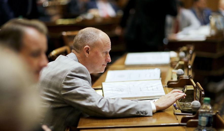 Georgia State Sen. Rick Jeffares, R - McDonough, prepares to vote on a bill he sponsored that allows craft breweries to sell directly to the consumer during the legislative session in Atlanta, Thursday, Feb. 2, 2017. The Senate voted 49-2 Thursday to approve the bill. The legislation will move to the House, where it has support from influential representatives. (AP Photo/David Goldman)
