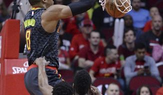 Atlanta Hawks center Dwight Howard (8) dunks against the Houston Rockets during the first half of an NBA basketball game Thursday, Feb. 2, 2017, in Houston. (AP Photo/George Bridges)